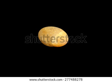 beautiful colorful stone, isolated on a black background - stock photo