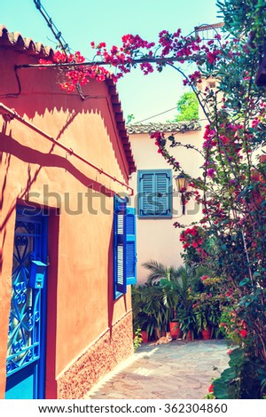 Beautiful colorful street in Athens, Greece. National architecture in the ancient district of Plaka. Vintage filter