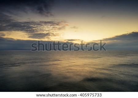 Beautiful colorful sunrise landscape over calm sea