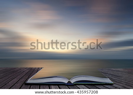Beautiful colorful sunrise landscape over calm sea with blur effect added - stock photo