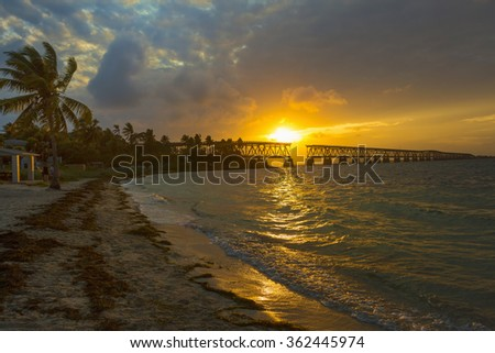 Beautiful colorful sunset or sunrise with broken bridge.  Florida Keys. - stock photo