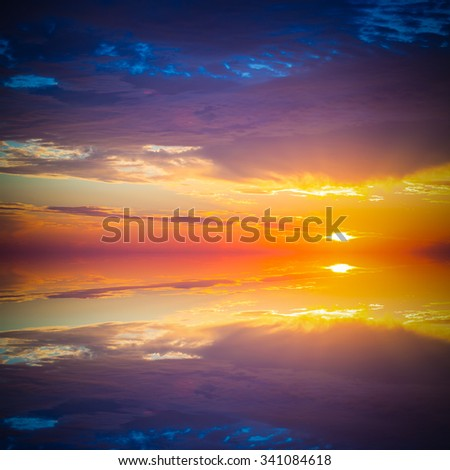 Beautiful colorful sunset over mediterranean sea is reflected in mirror water of harbor in Alanya Turkey. Toned.