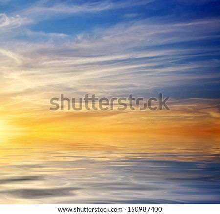 Beautiful colorful sunset sky and ocean. Sky background  - stock photo