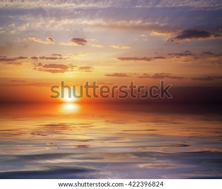 Beautiful colorful sunset sky and ocean. Sunrise in the sea.  - stock photo