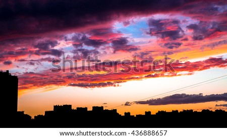 Beautiful colorful sunset under the city in the evening without any effects. Sky consist of many rainbow colors: red, orange, yellow, blue, violet.