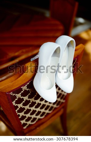 Beautiful colorful wedding shoes for bride indoors. Beauty of bridal heel for marriage. Female couple boots for celebration - stock photo