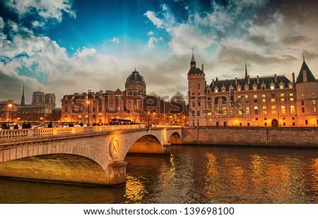 Beautiful colors of Napoleon Bridge at dusk with Seine river - Paris. - stock photo