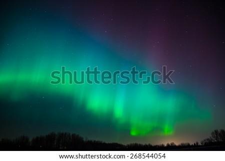 Beautiful colors of the Northern Lights (Aurora Borealis) - stock photo