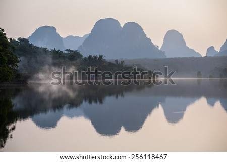 Beautiful colors of the sky,water reflection during sunrise at Ban Nong Thale Krabi Province in Thailand