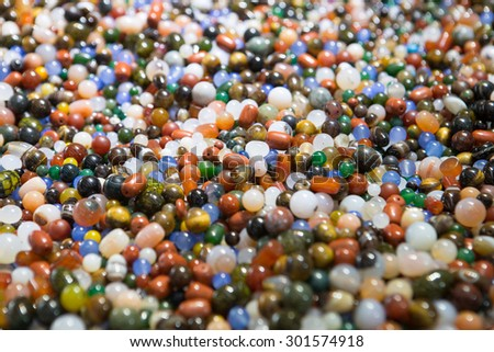 Beautiful colourful background consisting of beads - stock photo