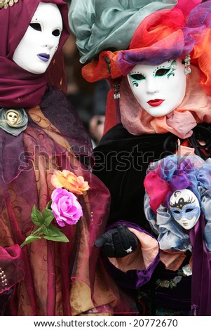 Beautiful colours of decorative carnival costume in Venice, Italy - stock photo