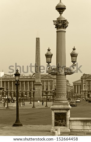 Beautiful column decorated with lanterns on the Place de la Concorde in Paris, France - stock photo