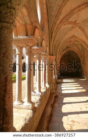 Beautiful columns and arches decorate the cloister of the Fontfroide Abbey, Languedoc-Roussillon, France