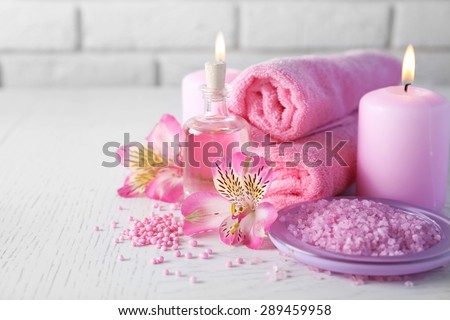 Beautiful composition of spa treatment on white wooden table - stock photo