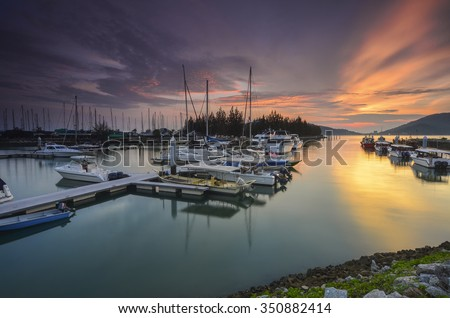 Beautiful composition view of Malaysian Harbour with a yatch during sunset.Vibrance colour. - stock photo