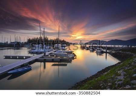 Beautiful composition view of Malaysian Harbour with a yatch during sunset.Vibrant colour. - stock photo