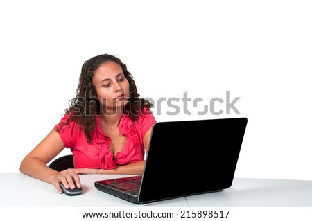 Beautiful computer savvy young woman using a laptop