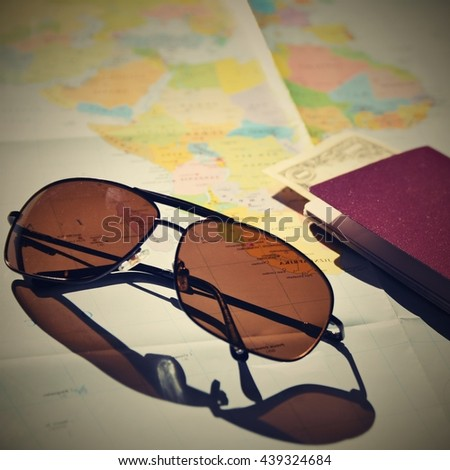 Beautiful concept for summer travel. Sunglasses with passport. Planning a summer vacation and holidays.