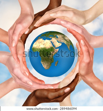 Beautiful conceptual symbol of the Earth globe with multiracial human hands around it. Unity and world peace concept. Elements of this image furnished by NASA