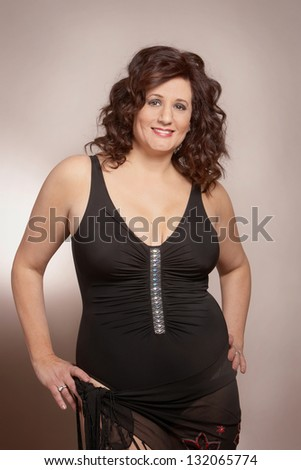 Beautiful confident adult woman in bathing suit - stock photo