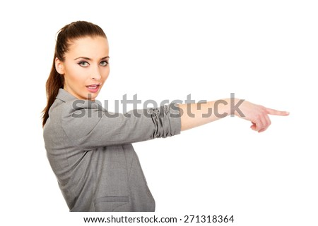 Beautiful confident businesswoman pointing aside. - stock photo