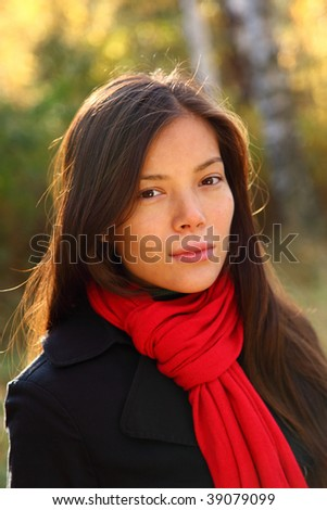 Beautiful confident young woman portrait. Outdoors in the autumn forest
