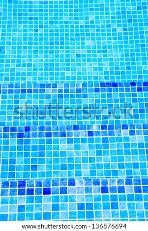 beautiful cool water in swimming pool mosaic bottom