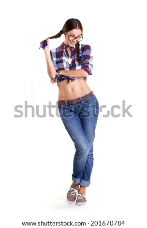 beautiful coquette in big glasses and  casual clothes with bared belly  isolated on white