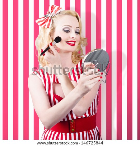 Beautiful cosmetic woman applying make-up base foundation. Perfect pinup makeup - stock photo