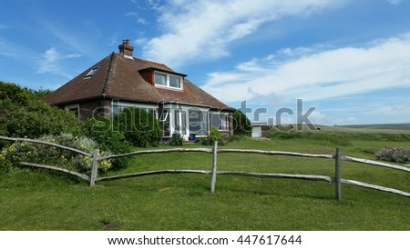 Beautiful cottage on cliffs over the sea in England, at Seven Sisters Country Park