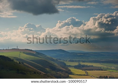 Beautiful countryside landscape across rolling hills with lovely cloud formations