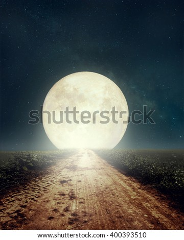 Beautiful countryside road with Milky Way star in night skies, full moon - Retro style artwork with vintage color tone(Elements of this moon image furnished by NASA) - stock photo