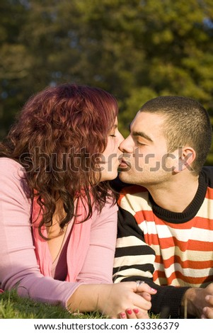 Beautiful couple about to kiss outdoor - stock photo
