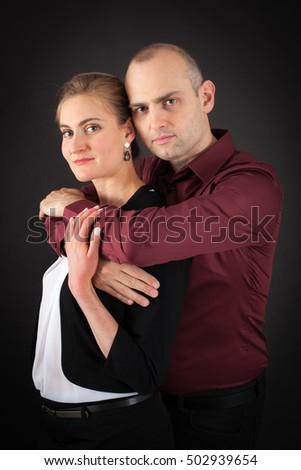 Beautiful couple doing different expressions in different sets of clothes: arms crossed
