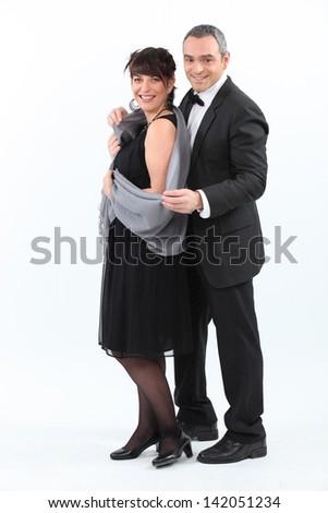 beautiful couple dressed to kill - stock photo
