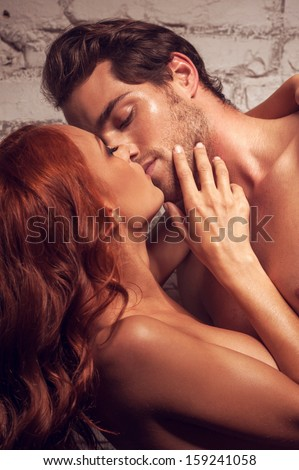Beautiful couple having sex. Kissing each other being nude  - stock photo
