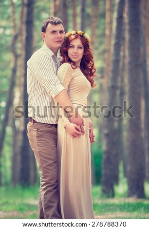 Beautiful couple holding hands in the park, first love, romantic date outdoors, sensual relationship, love and togetherness concept - stock photo