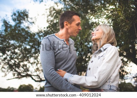 beautiful couple hugging near a tree