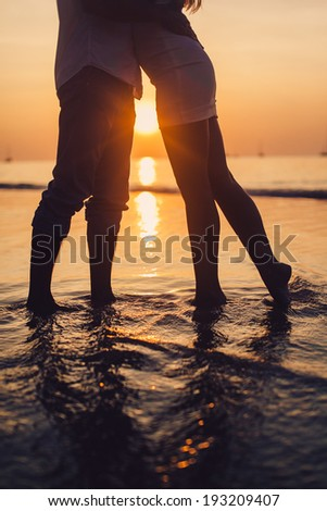 beautiful couple hugs each other on the beach