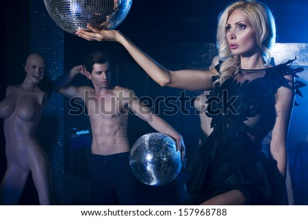 Beautiful couple in club - stock photo