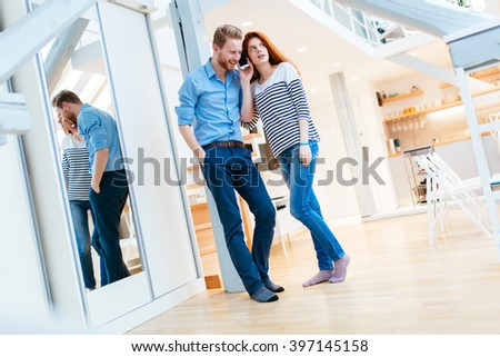 Beautiful couple in gorgeously designed apartment posing and bonding