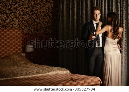 Beautiful couple in love in bedroom. Luxury. - stock photo