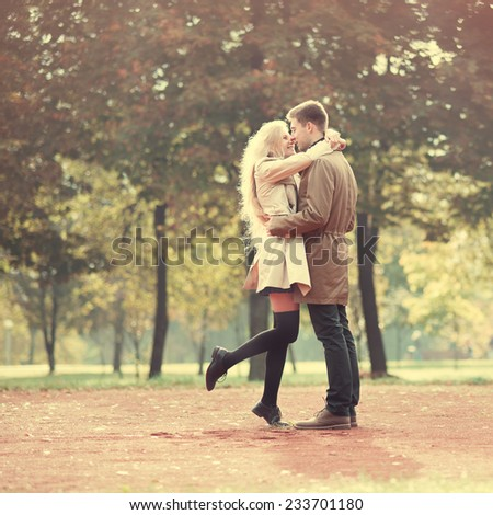 beautiful couple in love in park in spring - stock photo