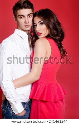 beautiful couple in love in red background - stock photo