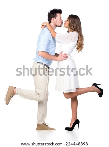 Beautiful couple in love kissing, isolated on white background - stock photo