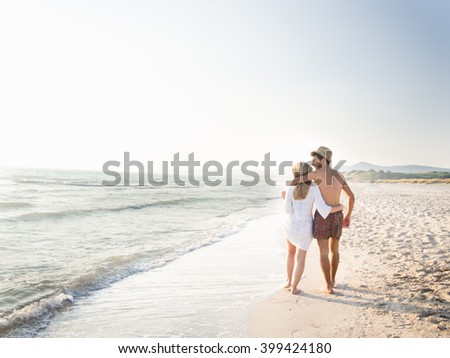 Beautiful couple in love on the beach - stock photo