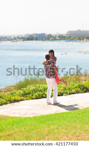 beautiful couple in love outdoors - stock photo