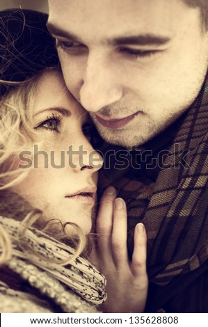 beautiful couple in love pressed against each other - stock photo