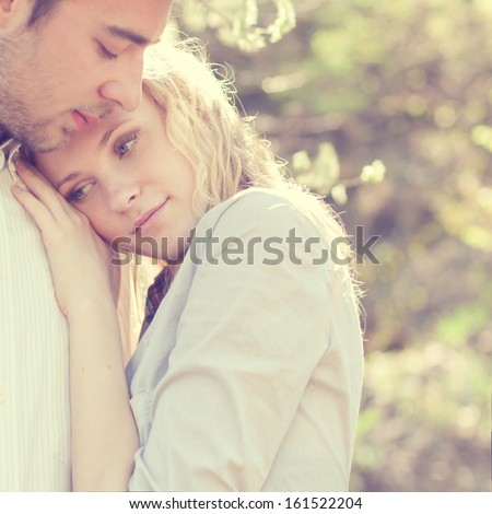 beautiful couple in love tenderly embraces - stock photo