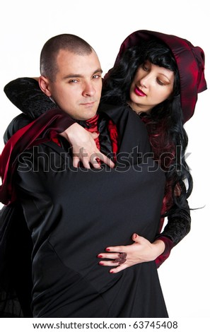 Beautiful couple in medieval vampire costumes, studio shot isolated on white